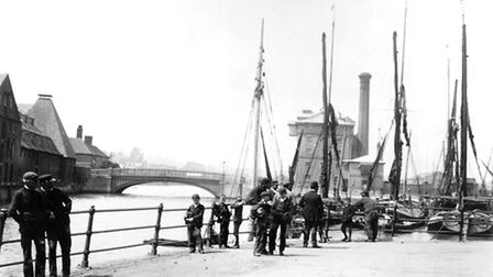 Stoke Bridge is in the background of this 1890s photograph