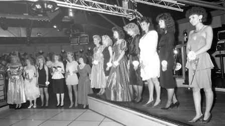 All the contestants lined up on stage as the judges decided who would be the carnival queen for 1989