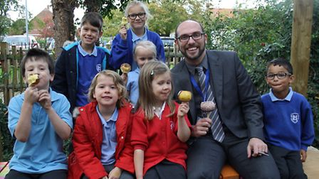 Pupils with Paul Stock at Rushmere Hall Primary School's apple-themed welcome event