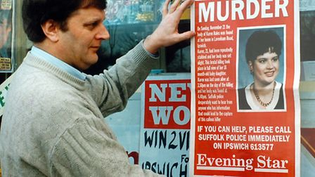 An Ipswich newsagent putting up the Evening Star murder poster in November 1993 after the death of