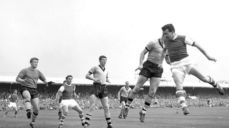 Ipswichs Roy Rocky Stephenson challenges for the ball at Portman Road in September 1962 during a
