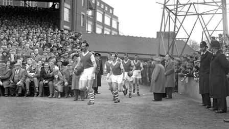 Captain Andy Nelson leading the team out in the early 1960s