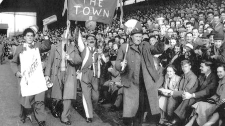 Ipswich Towns cheerleader Swede Herring rousing the crowd at Portman Road. Swede was a bus conduc