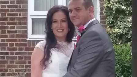 Louise Day in the dress with her husband Michael on their wedding day