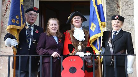 The Mayor of Bury St Edmunds, Julia Wakelam, is joined by members of the Royal British Legion to lau