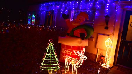 Vikki and Lawrence Bugeja enjoy putting their Christmas lights up early.
