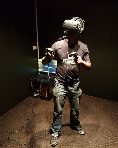 Morris Grant shows off the virual reality headset