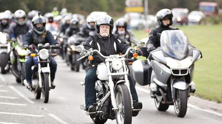 Hundreds of motocyclists escort the coffin of David Martin on its final journey to Seven Hills Crema