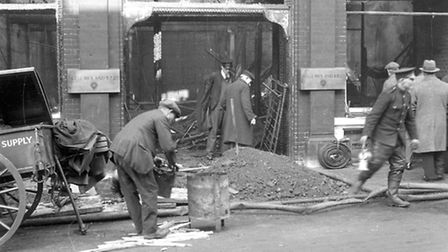 Clearing up after the fire at the Shell Mex and BP building in Princes Street in 1932