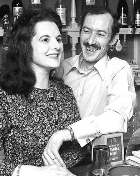 John and Janet Simpson behind the bar at the Garland public house, Ipswich, in 1974.