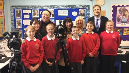 Pupils at Holbrook Primary School with members of the EBS Korea team