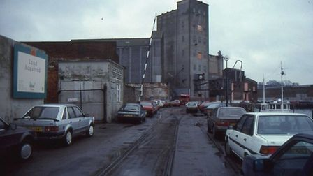The wet dock with the now-demolished industrial buildings, taken by John Field in the mid 1970s