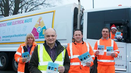 Phil Smart with a team of refuse collectors and the leaflet highlighting the Christmas changes