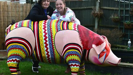 Sam and Wendy Beckett at home with Piggy Stardust.