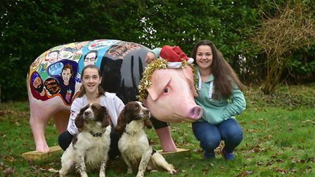 Annie and Maddie Shelley with dogs Oz and Marley with the South Street Radio pig.