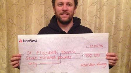 Rupert Pheasant with a cheque for St Elizabeth Hospice following the Moat Barn fundraiser