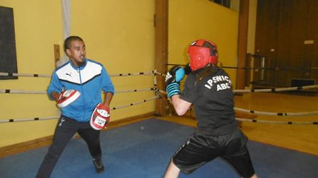 Head coach Monju Miah supervises young boxers in the ring, Coby Wright and Joe Last