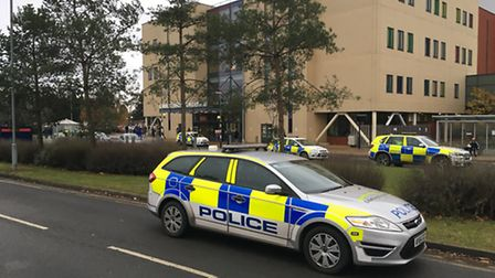 Police at Ipswich Hospital after the double stabbing in Ipswich