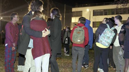 Students gather as fire breaks out at a block of flats in Grimwade Street, Ipswich