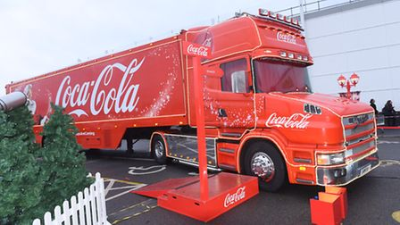 Shoppers queue at Whitehouse ASDA to see the Coca-Cola Christmas Truck in Ipswich.