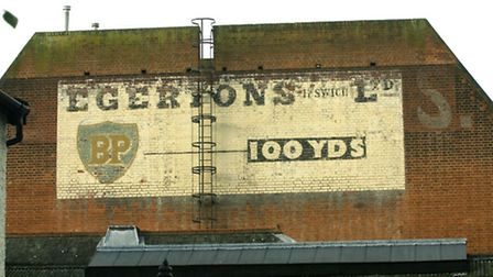The sign for Egerton's garage on the back wall of what is now the Robert Ransome public house.