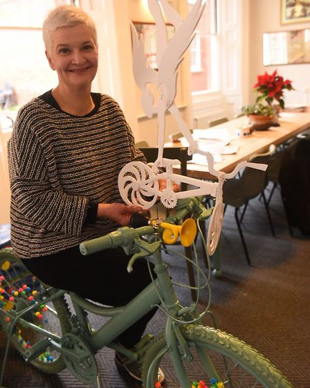 La Tour Cycle Cafe owner Anna Matthews with the cycle themed Christmas tree topper made by Lois Cord