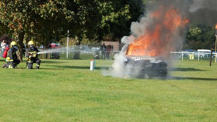 File picture of firefighters tackling a car blaze.
