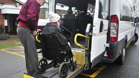 Staff from FACTS (Felixstowe Area Community Transport Scheme) helping a person in a wheelchair into