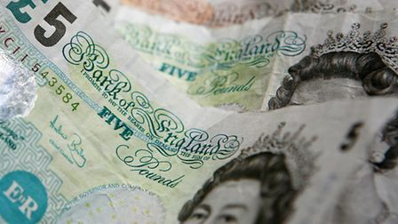 Woman admits money laundering charge
