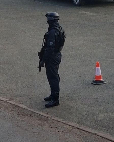 Armed police, including dog units, are at the scene. Image: Glen Marney