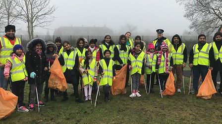 Local residents and PCSOs join forces to clean up the area near Ipswich Hospital.