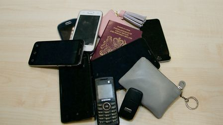 The group of items found in Ipswich taxis this month, including phones, purses, Audi key fob and pas