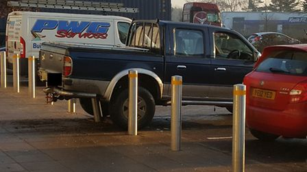 The scene of the Ford Ranger impaled on a bollard after the botched ram-raid attempt at the Co-op in