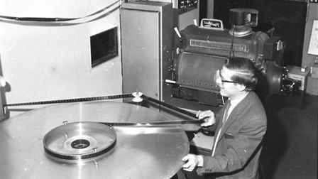 The ABC Cinema projectionist preparing a new roll of film. June 1973.