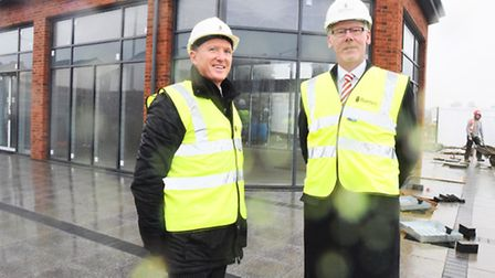 Left to right, Mark Bailey (Barnes Construction) and Nick Denny (Co-op Chief Exec) at work for the R