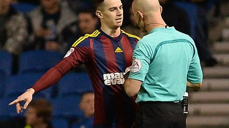 Tom Lawrence talks to the referee at Brighton