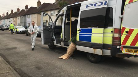 Police have removed cannabis from the scene of a house fire in Reading Road