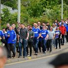 Ipswich Town fans make their way to Carrow Road football stadium in Norwich. Picture: ASHLEY PICKERI