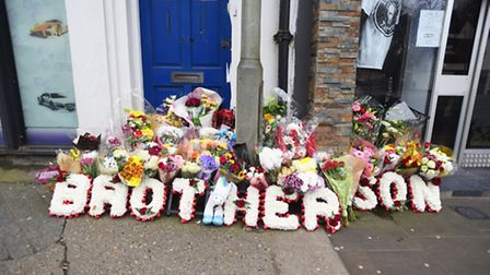 Floral tributes outside Lucky 13 Tattoo Studio, St Margaret's Street, Ipswich.