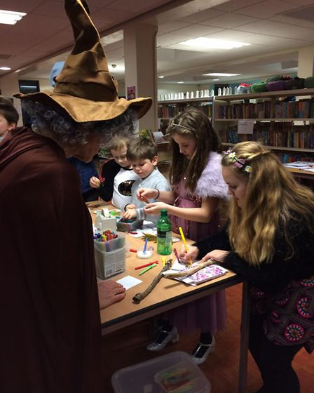 Professor Sprout overseeing mask making in Chantry library.
