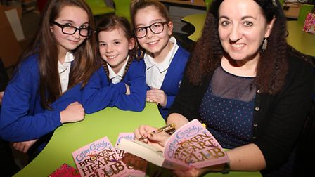 Author Cathy Cassidy with Claydon Primary School pupils Maddie Smith, Aimee Burningham and Annabelle