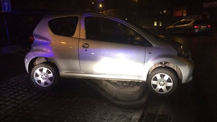 Police called a recovery vehicle to lift the car off the curb. Photo by N&S roads policing