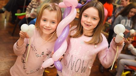 Sisters, left to right, Eve and Lilly Crossley enjoy a balloon-modelling class at Chantry Library. P