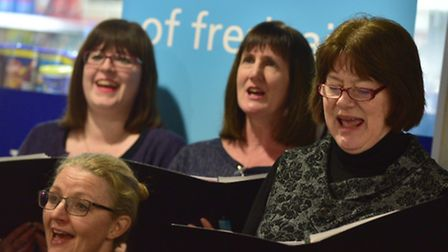 The Ipswich Community Choir sings to visitors at the entrance of A&E at Ipswich Hospital. Picture: S