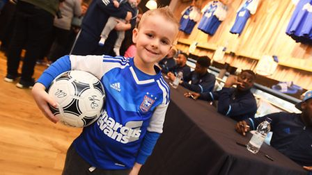Ipswich Town players sign autographs for fans at Planet Blue, Portman Road. Pictured is Jamie Hart.