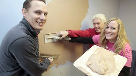 Nichola Whymark completing her last challenge of plastering of a wall, alongside her dad, Terry and
