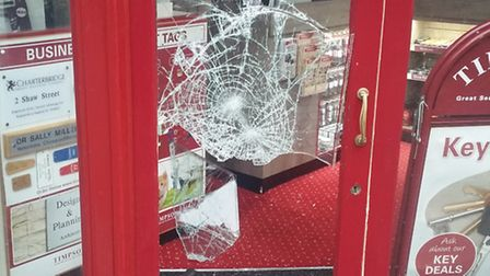 Glass smashed at Timpson in Ipswich. Picture: SHANE DALY