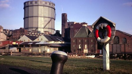 The German gas holder viewed from across the Wet Dock. The brick buildings on the right are Paul's E