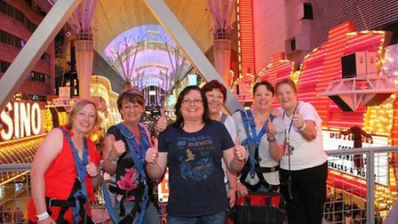 The group celebrate after braving a zipline on their trip to Las Vegas