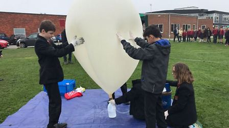 Pupils at Sandringham School in Hertfordshire prepare to launch the balloon for their computer scien